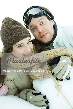 Brother and sister in snow, smiling at camera, portrait Stock Photo - Premium Royalty-Free, Image code: 695-05766588