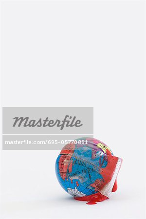Adhesive bandage soaked in blood wrapped around globe Stock Photo - Premium Royalty-Free, Image code: 695-05770881