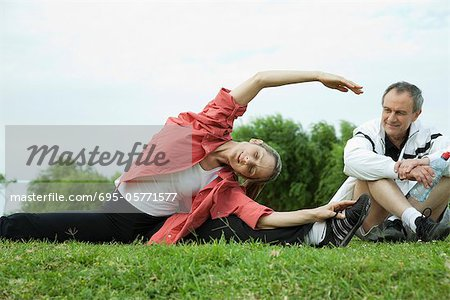 Mature couple stretching in park Stock Photo - Premium Royalty-Free, Image code: 695-05771577