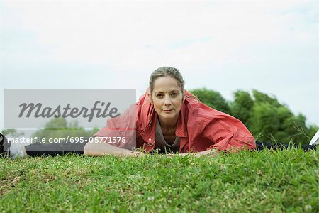 Mature woman stretching in park Stock Photo - Premium Royalty-Free, Image code: 695-05771578