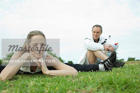 Mature couple stretching in park Stock Photo - Premium Royalty-Free, Image code: 695-05771579