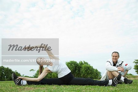 Mature couple stretching in park Stock Photo - Premium Royalty-Free, Image code: 695-05771580