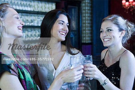 Friends celebrating together in bar Stock Photo - Premium Royalty-Free, Image code: 695-05771592