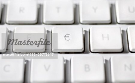 Euro sign on laptop computer keyboard Stock Photo - Premium Royalty-Free, Image code: 695-05771643