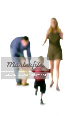 Silhouette of parents and two children, on white background, defocused Stock Photo - Premium Royalty-Free, Image code: 695-05773504