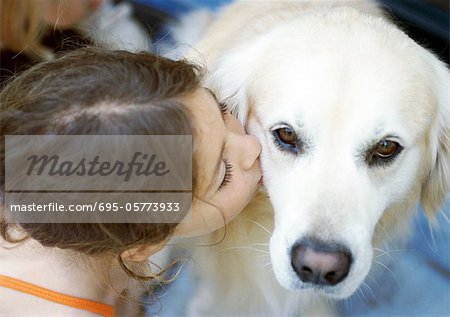 Girl kissing dog, elevated view Stock Photo - Premium Royalty-Free, Image code: 695-05773933