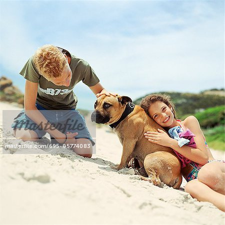 Children with dog on the beach Stock Photo - Premium Royalty-Free, Image code: 695-05774083