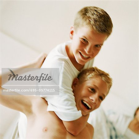 Two boys playfighting Stock Photo - Premium Royalty-Free, Image code: 695-05774115