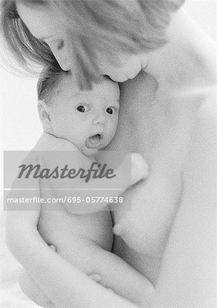 Topless mother holding infant against chest, b&w Stock Photo - Premium Royalty-Free, Image code: 695-05774638