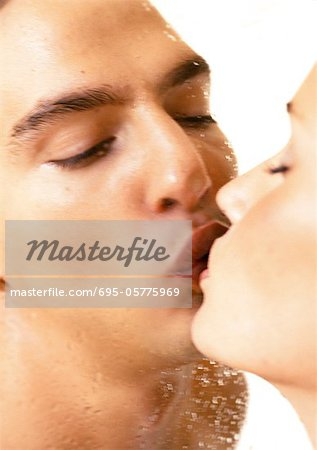 Couple kissing through wet shower door, close-up Stock Photo - Premium Royalty-Free, Image code: 695-05775969