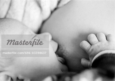 Baby being breastfed, close-up, b&w Stock Photo - Premium Royalty-Free, Image code: 696-03398637