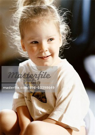 Little girl sitting Stock Photo - Premium Royalty-Free, Image code: 696-03398649