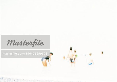 People at beach, blurred. Stock Photo - Premium Royalty-Free, Image code: 696-03399603