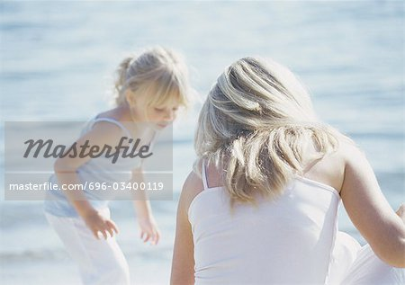 Woman and girl at seaside Stock Photo - Premium Royalty-Free, Image code: 696-03400119
