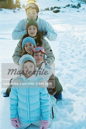 Young friends in snow, portrait Stock Photo - Premium Royalty-Free, Image code: 696-03401678