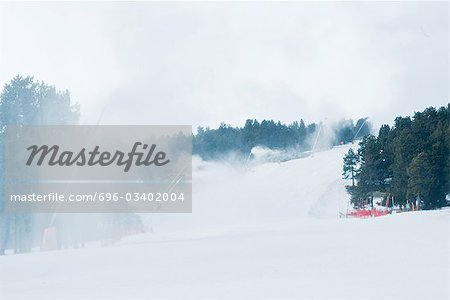 Ski slopes, artificial snow being sprayed Stock Photo - Premium Royalty-Free, Image code: 696-03402004