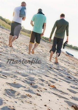 Men walking on beach