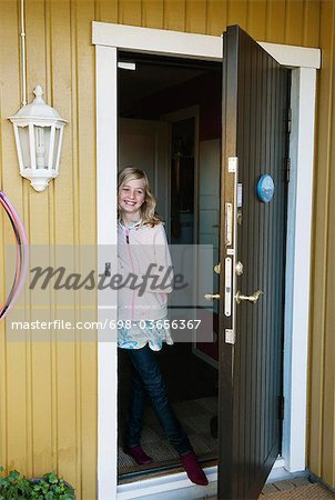 Young girl on the threshold Stock Photo - Premium Royalty-Free, Image code: 698-03656367