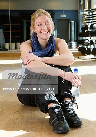 Happy girl after working out Stock Photo - Premium Royalty-Free, Image code: 698-03657131