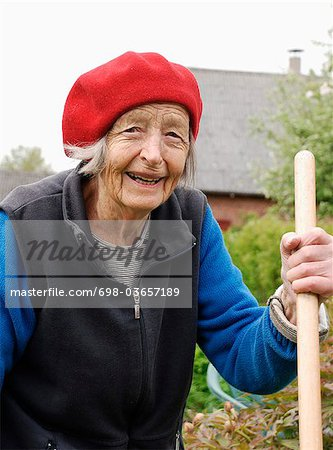 Old woman in garden Stock Photo - Premium Royalty-Free, Image code: 698-03657189