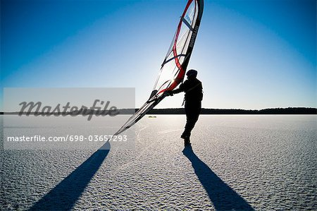 Long-distance skating with sail Stock Photo - Premium Royalty-Free, Image code: 698-03657293