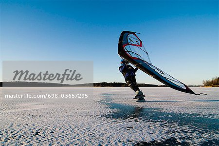Ice skating with sail Stock Photo - Premium Royalty-Free, Image code: 698-03657295