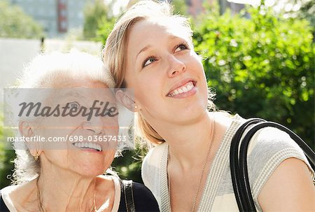 Two women looking up towards the sky Stock Photo - Premium Royalty-Free, Image code: 698-03657433