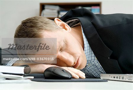 Man is sleeping on desk Stock Photo - Premium Royalty-Free, Image code: 698-03670015