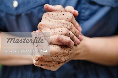 Dirty hands Stock Photo - Premium Royalty-Free, Image code: 698-05957374