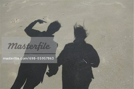 Shadow of couple on sand at beach Stock Photo - Premium Royalty-Free, Image code: 698-05957863