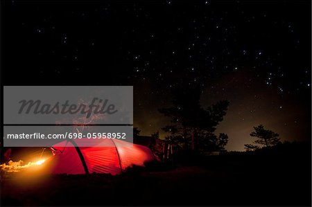 Glowing tent against night sky Stock Photo - Premium Royalty-Free, Image code: 698-05958952