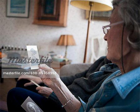 Older couple looking at photo Stock Photo - Premium Royalty-Free, Image code: 698-05958968