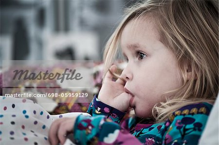 Girl sucking thumb Stock Photo - Premium Royalty-Free, Image code: 698-05959129
