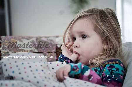 Girl sucking thumb Stock Photo - Premium Royalty-Free, Image code: 698-05959130
