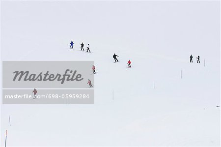 People in downhill ski slope Stock Photo - Premium Royalty-Free, Image code: 698-05959284