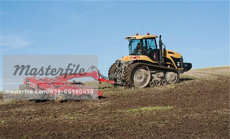 Farmer in tractor plowing field Stock Photo - Premium Royalty-Free, Image code: 698-05980498