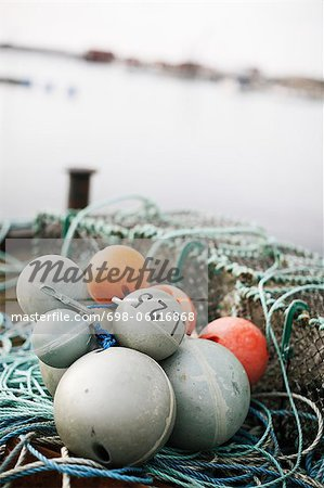 Close-up of fishing equipment buoy Stock Photo - Premium Royalty-Free, Image code: 698-06116868