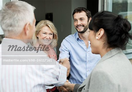 Multi ethnic business people shaking hands Stock Photo - Premium Royalty-Free, Image code: 698-06117161