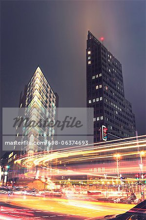 Night traffic lights with buildings in the background Stock Photo - Premium Royalty-Free, Image code: 698-06374693