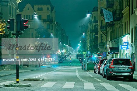 Night view of an empty city street Stock Photo - Premium Royalty-Free, Image code: 698-06374739