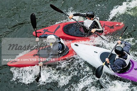 High angle view of people kayaking in rapid water Stock Photo - Premium Royalty-Free, Image code: 698-06374754