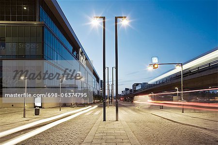 View of light trails on street on modern city at dusk Stock Photo - Premium Royalty-Free, Image code: 698-06374795
