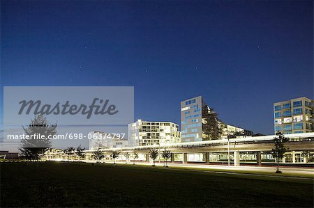 Illuminated skyline of city against clear sky Stock Photo - Premium Royalty-Free, Image code: 698-06374797