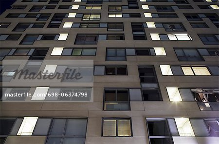 Low angle view of residential apartment building at night Stock Photo - Premium Royalty-Free, Image code: 698-06374798
