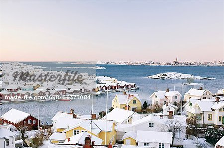 Sea and snow covered houses in winter Stock Photo - Premium Royalty-Free, Image code: 698-06375084