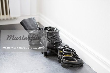 Family shoes lined up together Stock Photo - Premium Royalty-Free, Image code: 698-06375095