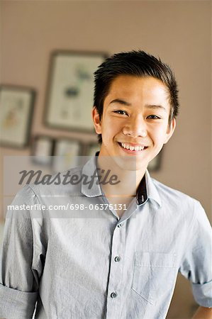 Portrait of a happy teenage boy smiling Stock Photo - Premium Royalty-Free, Image code: 698-06375131