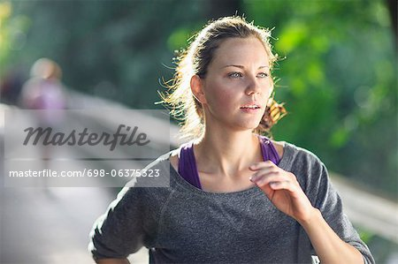 Young woman jogging Stock Photo - Premium Royalty-Free, Image code: 698-06375323