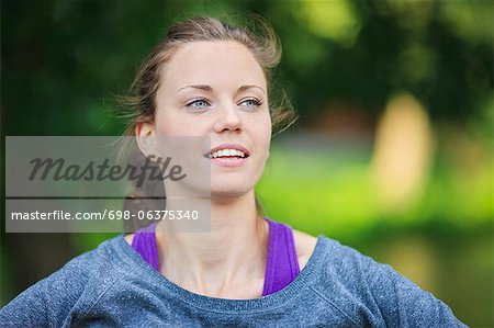 Young woman looking away Stock Photo - Premium Royalty-Free, Image code: 698-06375340