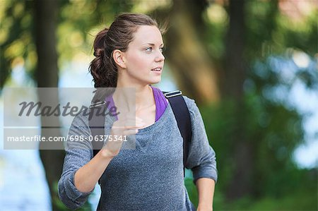 Young woman looking away as she jogs Stock Photo - Premium Royalty-Free, Image code: 698-06375341